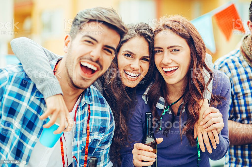 Happy friends on a party stock photo