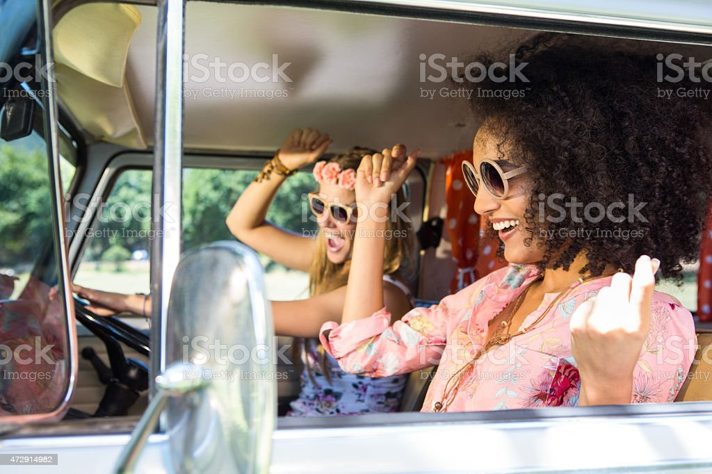 Happy friends on a road trip stock photo