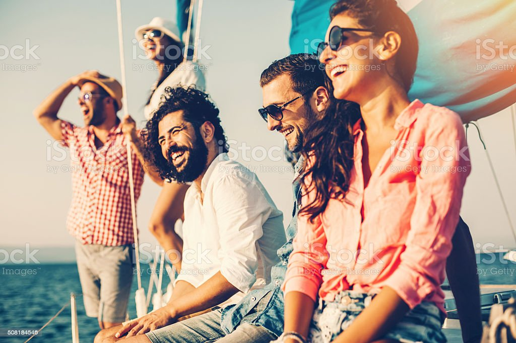Happy friends on a yacht stock photo