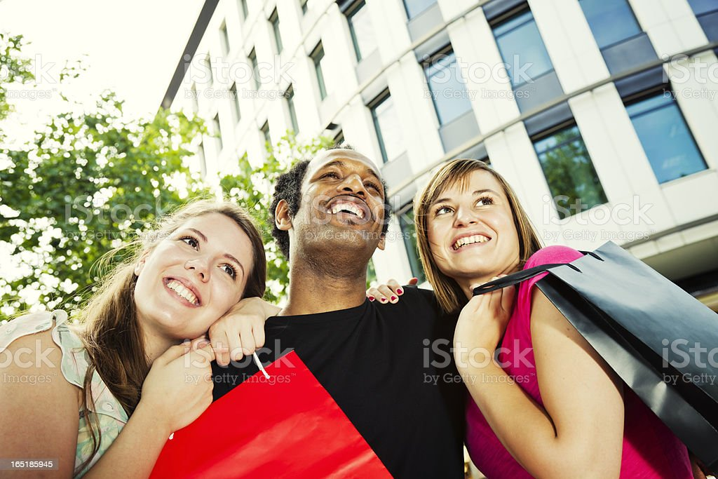 Happy friends on street after shopping stock photo