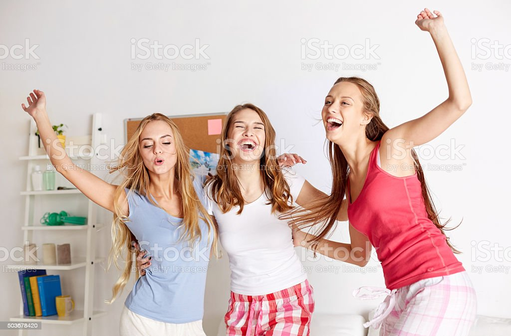 happy friends or teen girls having fun at home stock photo