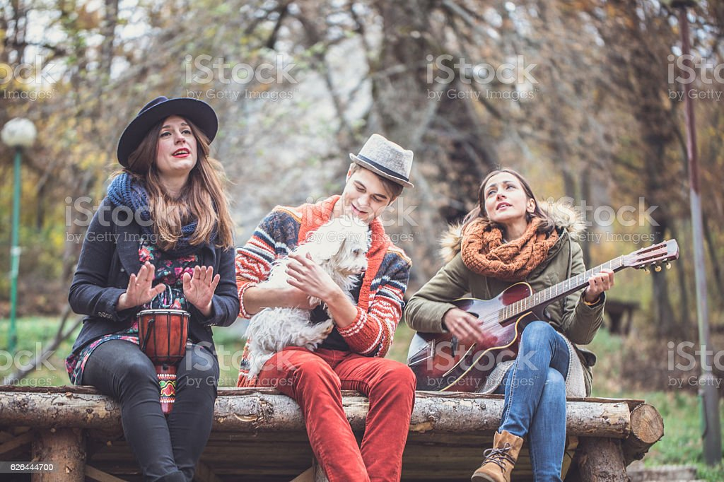 Happy friends playing music stock photo