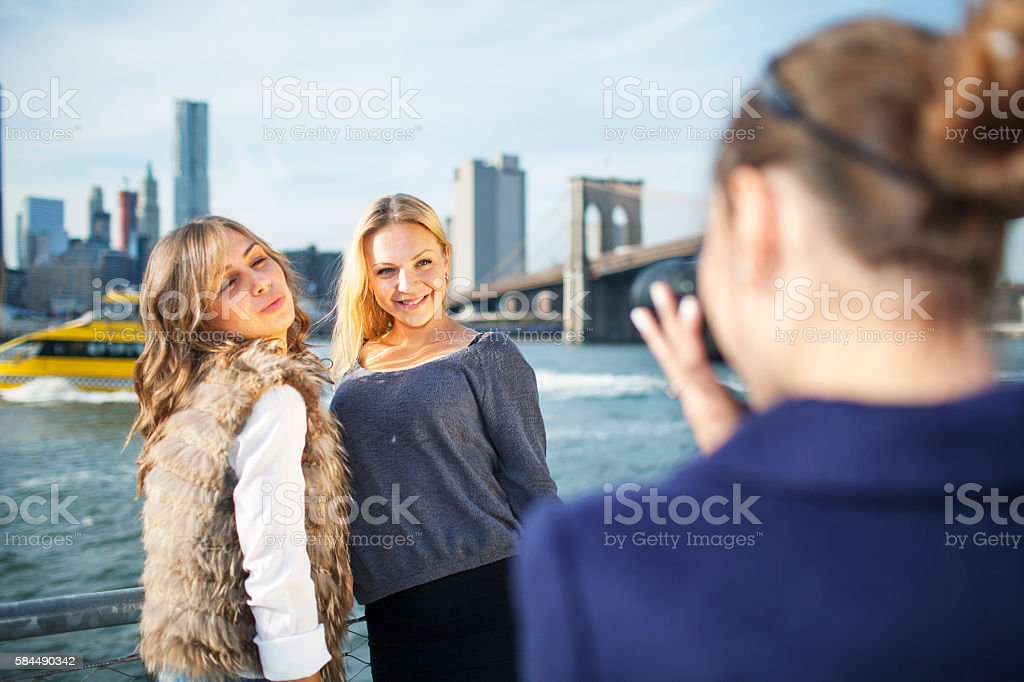 Happy friends posing for photos in New York City stock photo