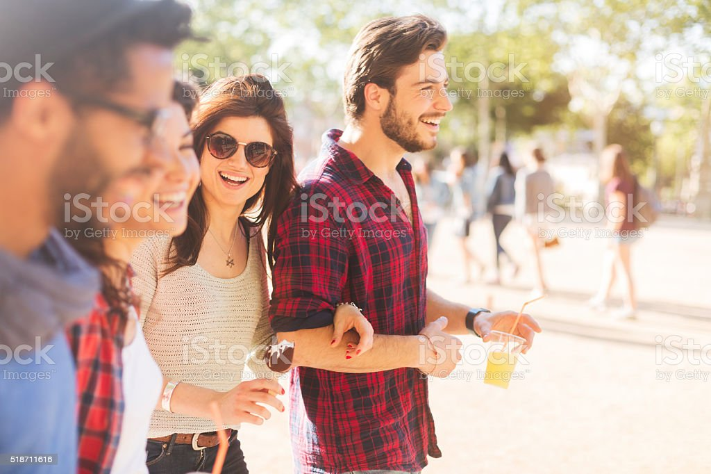 Happy friends sharing drinks and ready for summer stock photo