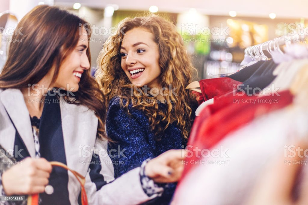 Happy friends shopping stock photo