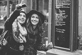 Happy friends sightseeing in Paris