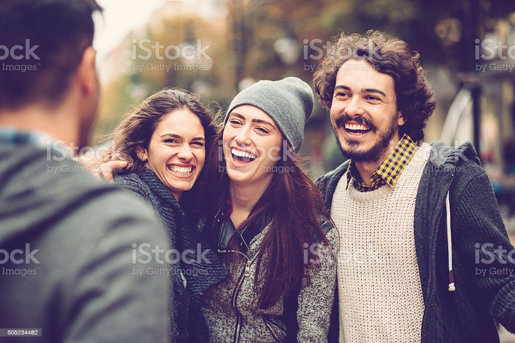 Happy friends smiling at urban stock photo