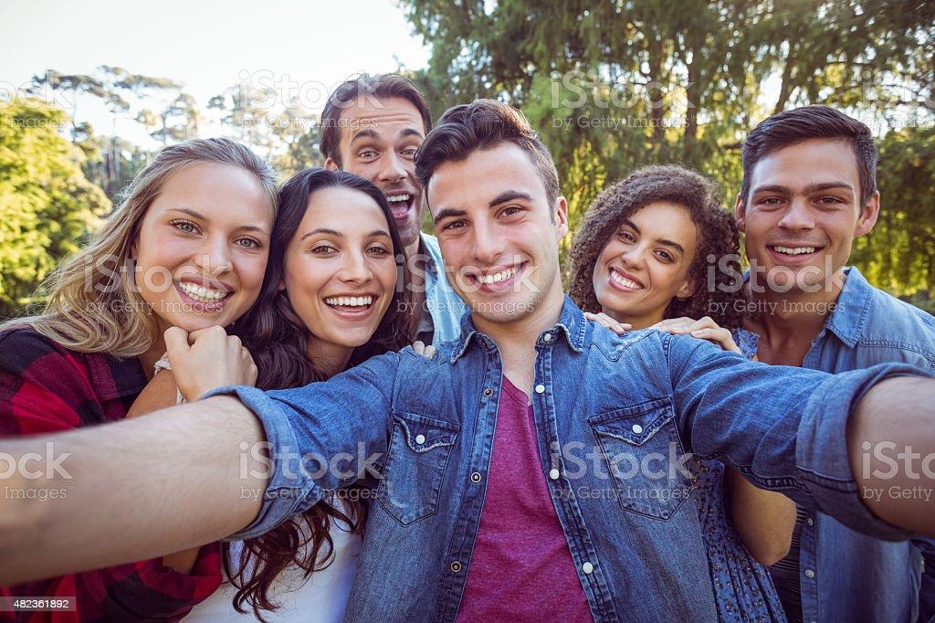 Happy friends taking a selfie stock photo