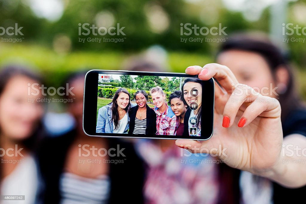 Happy friends taking selfie and laughing. stock photo