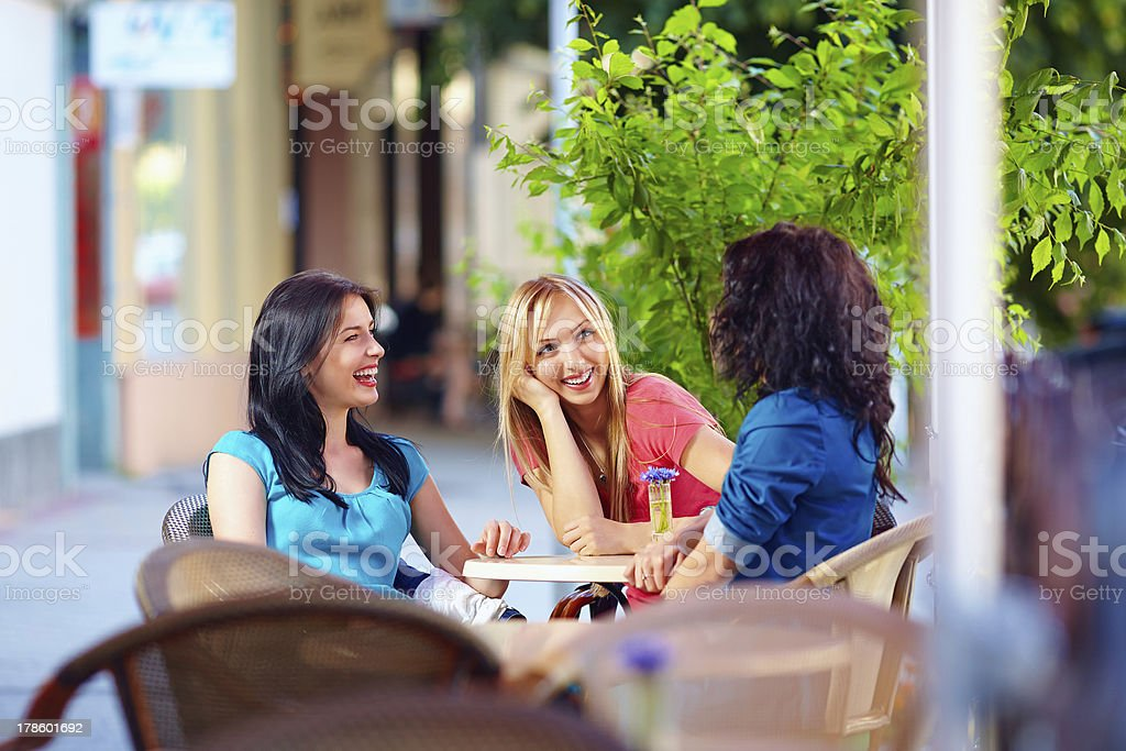 happy friends talking in summer cafe, urban outdoors royalty-free stock photo