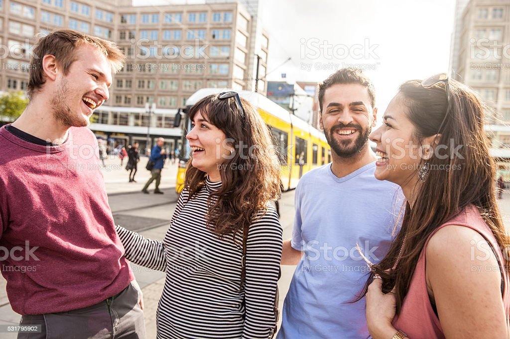 Happy friends together meet up to hang out stock photo