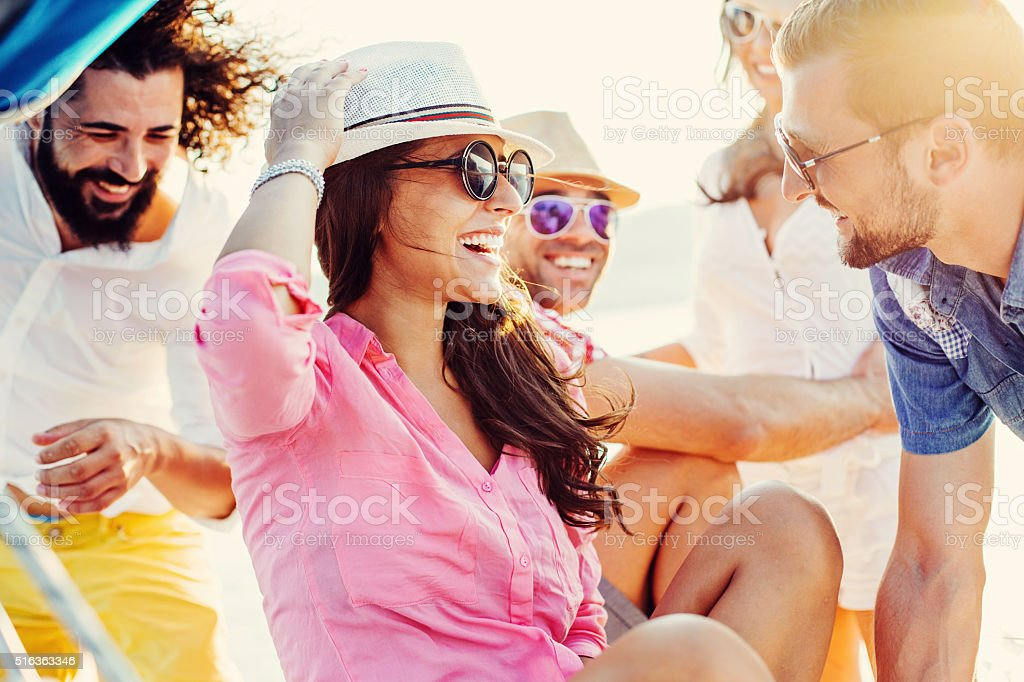Happy friends traveling on yacht stock photo