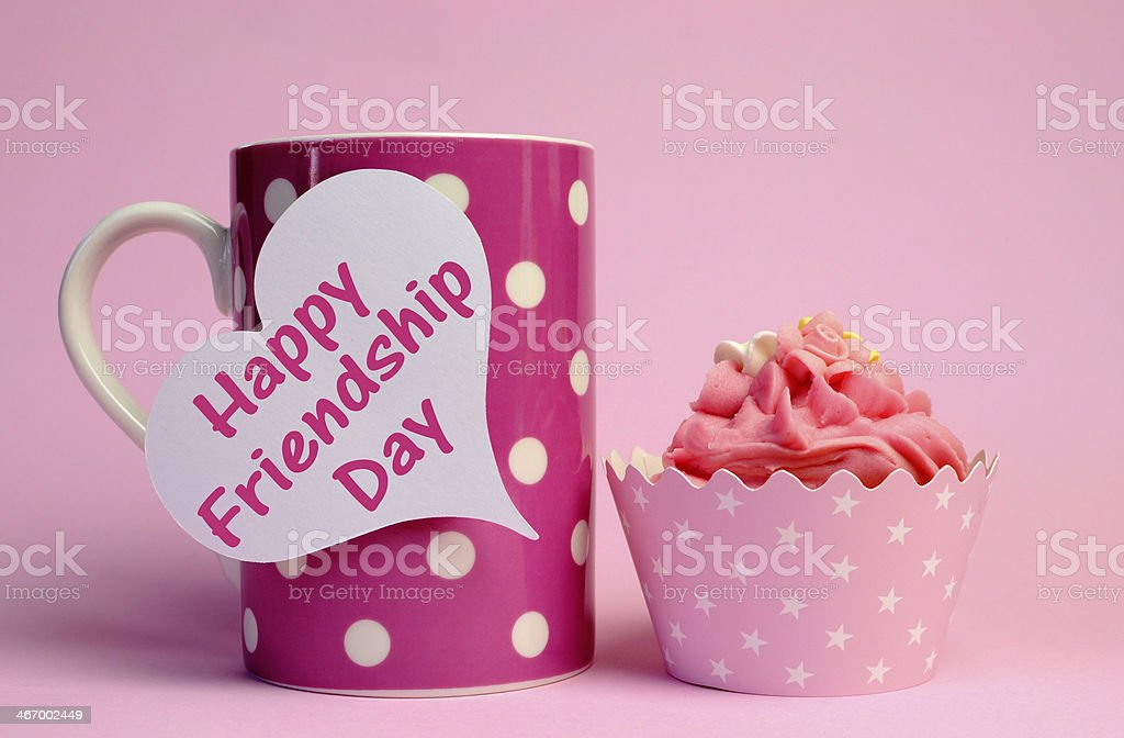 Happy Friendship Day with coffee mug and cupcake royalty-free stock photo