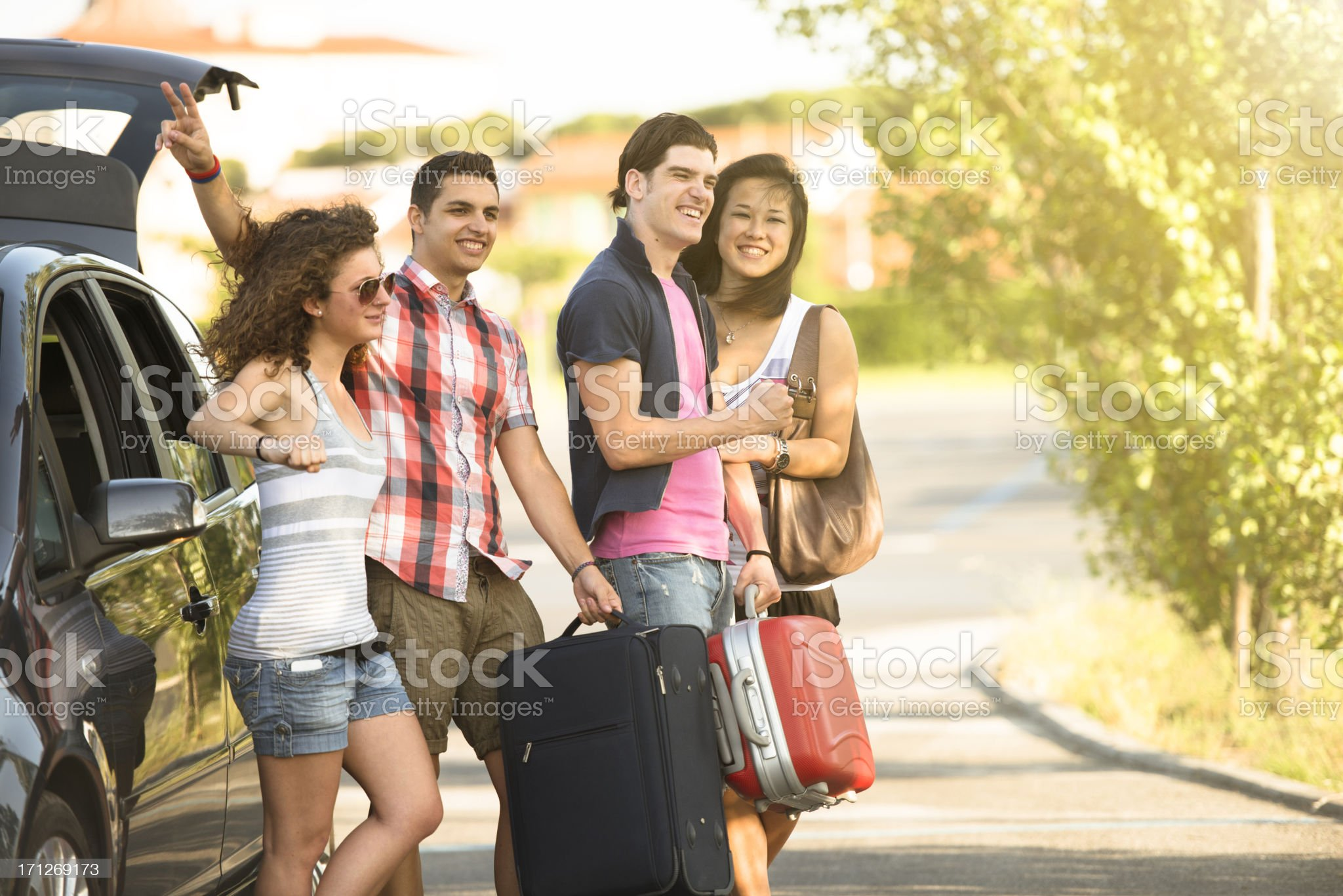 Happy friendship ready for a vacation with car royalty-free stock photo