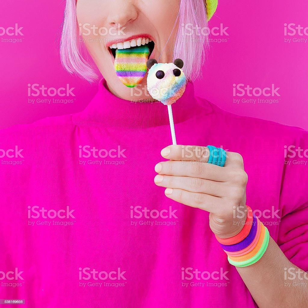 Happy funny girl. Love Sweets. Panda Candy and Rainbow stock photo