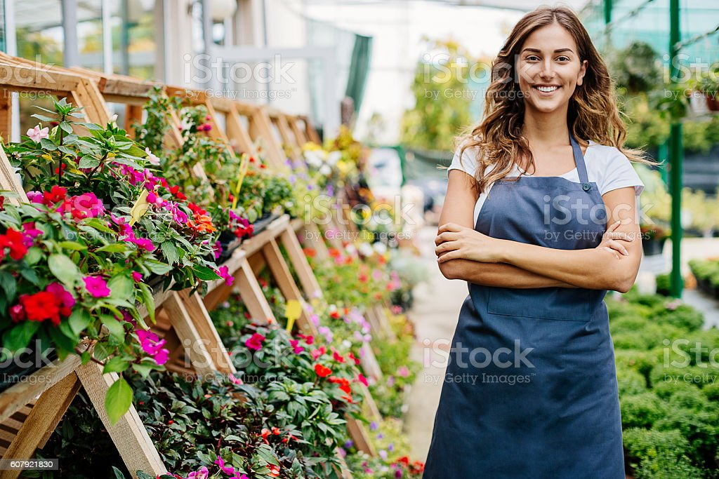 Happy garden center owner stock photo