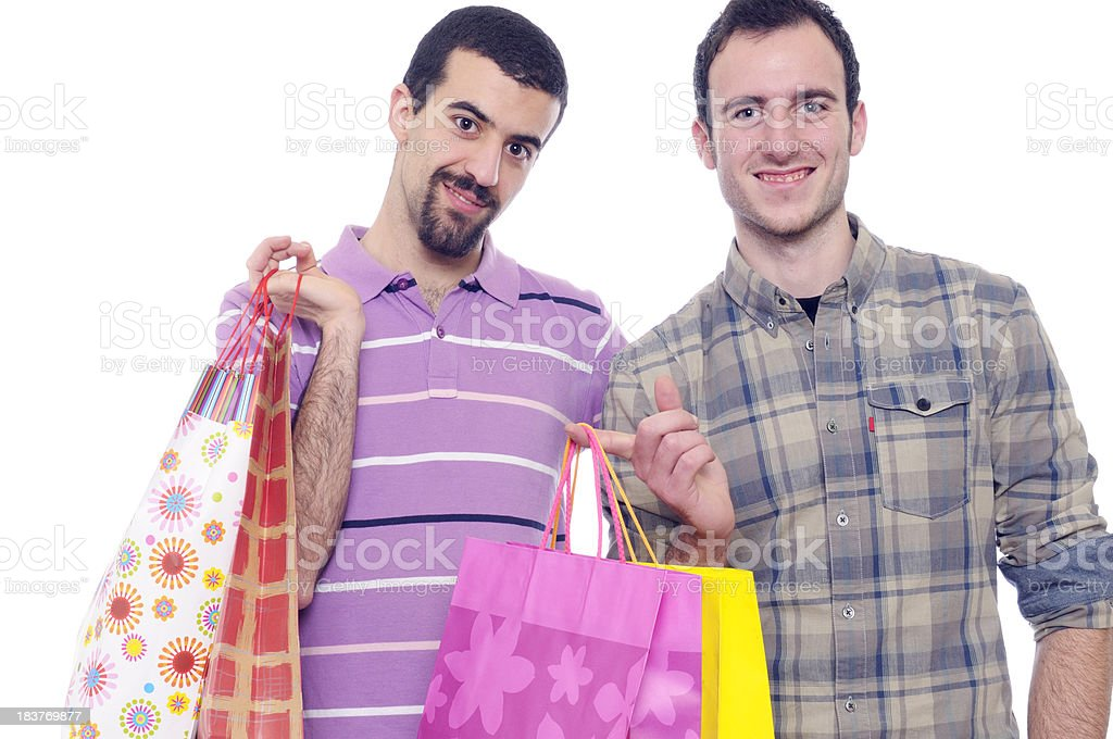 Happy Gay Men with Shopping Bags.Isolated royalty-free stock photo