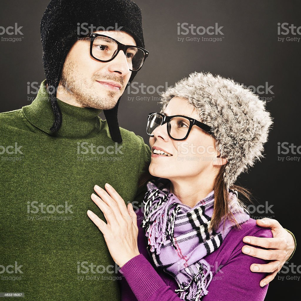 Happy Geek, nerdish couple hugging each other, horn rimmed glasses stock photo