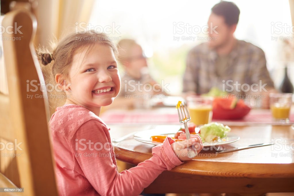 happy girl at lunch stock photo