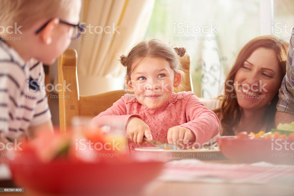 happy girl at mealtime stock photo