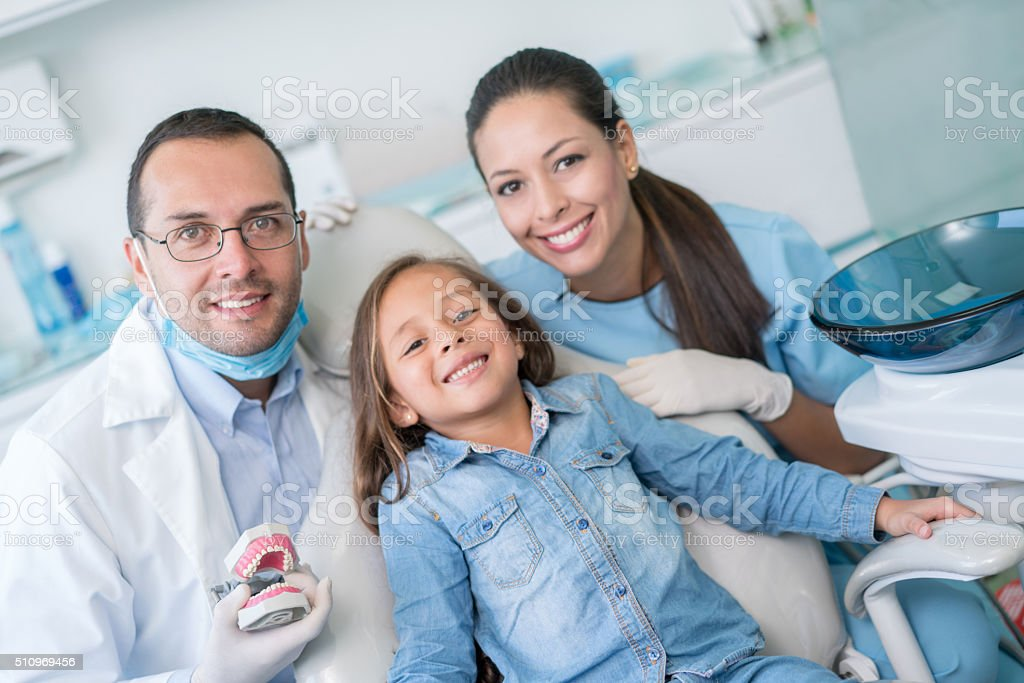 Happy girl at the dentist smiling stock photo