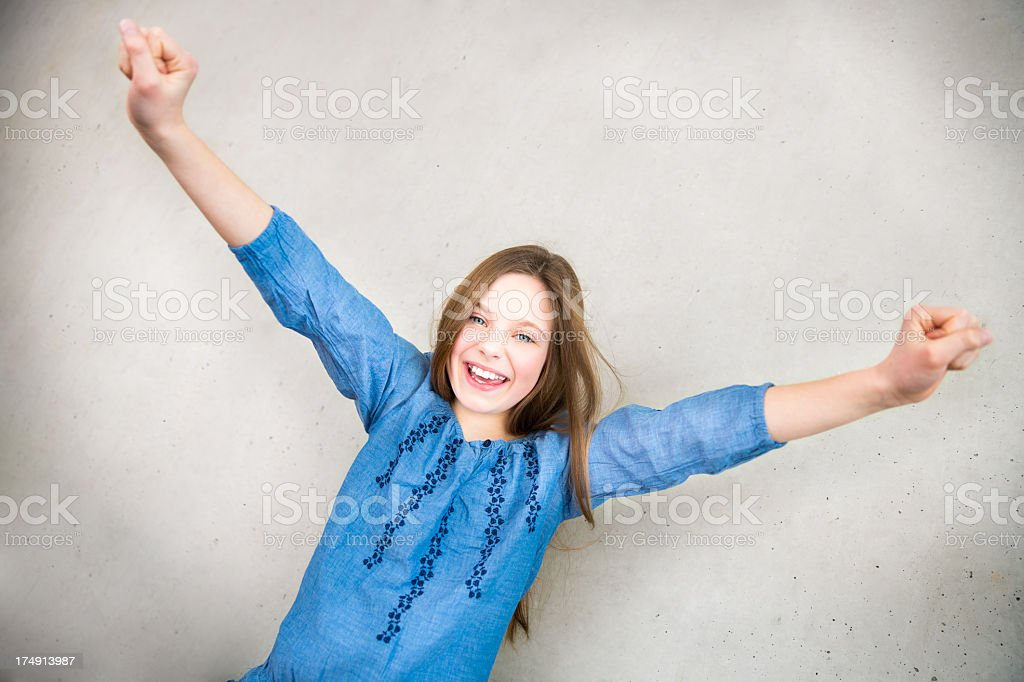 Happy girl cheering and celebrating royalty-free stock photo