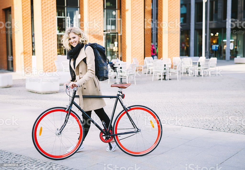 Happy Girl Cycling To Work stock photo