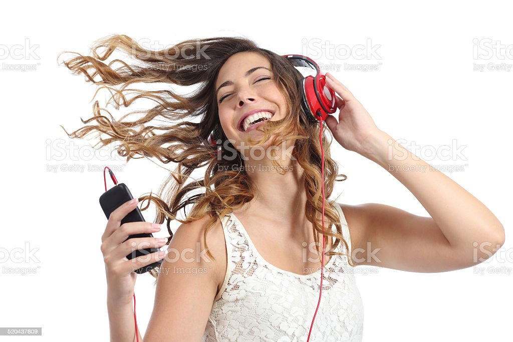 Happy girl dancing and listening to the music stock photo
