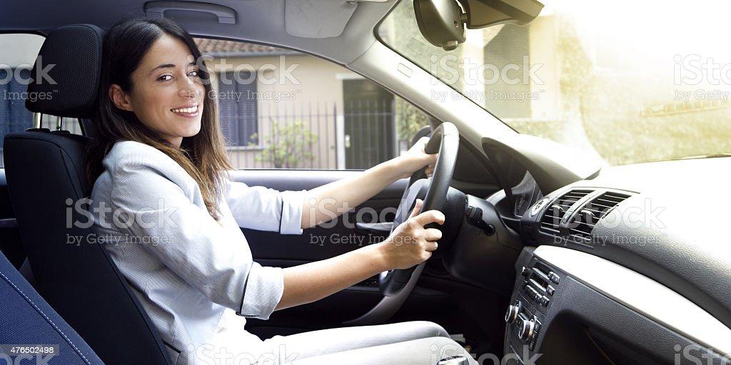 Happy girl driving stock photo