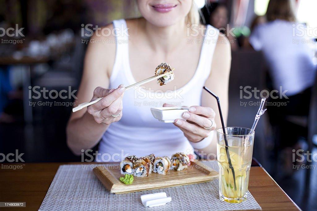 Happy Girl Eating Sushi royalty-free stock photo