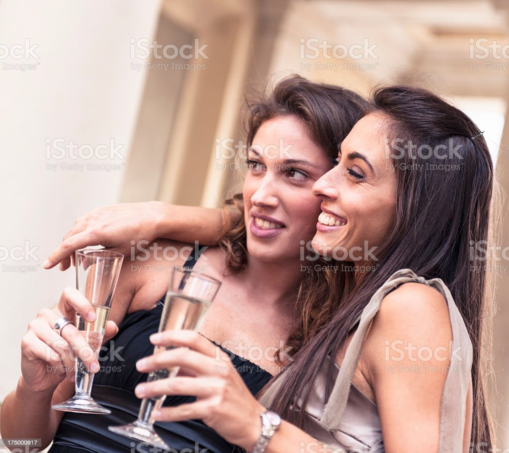 Happy Girl embracing outdoors with champagne royalty-free stock photo