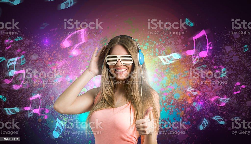 Happy girl enjoying in music stock photo