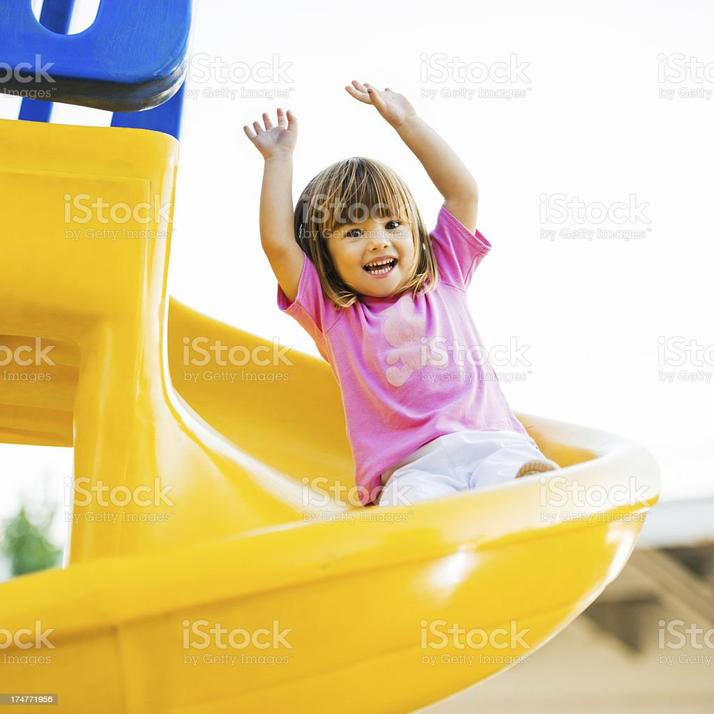 Happy girl enjoying in the Playground. royalty-free stock photo
