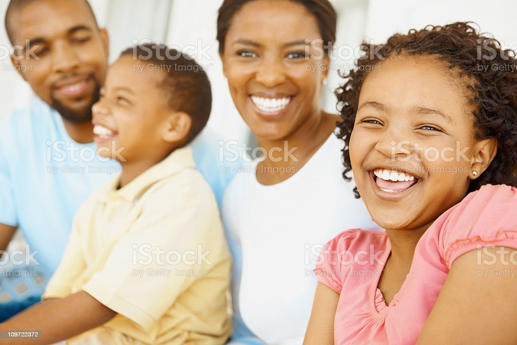 Happy girl enjoying with her family royalty-free stock photo