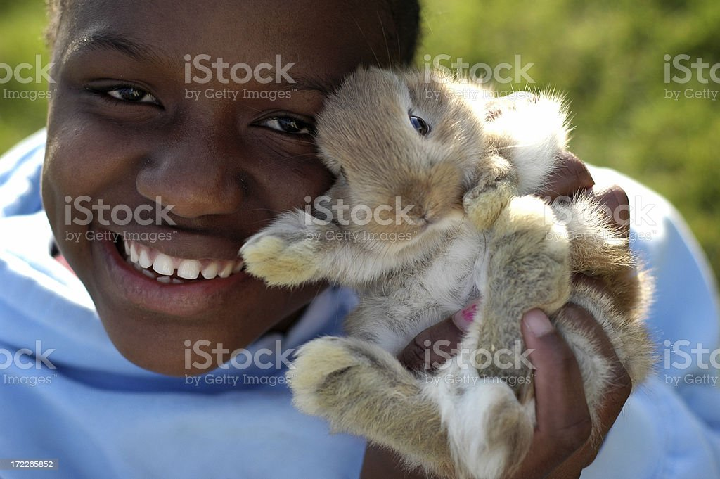 Happy Girl Holding a Cute Bunny Friend royalty-free stock photo