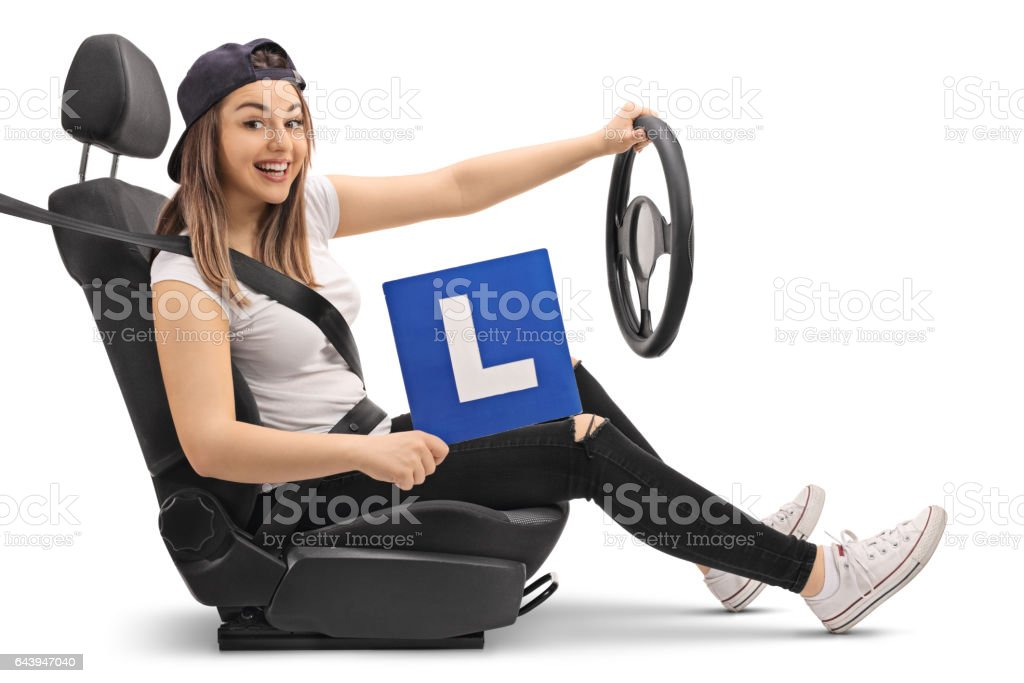 Happy girl holding an L-sign and pretending to drive stock photo