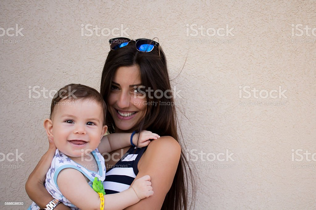 Happy girl holding child stock photo
