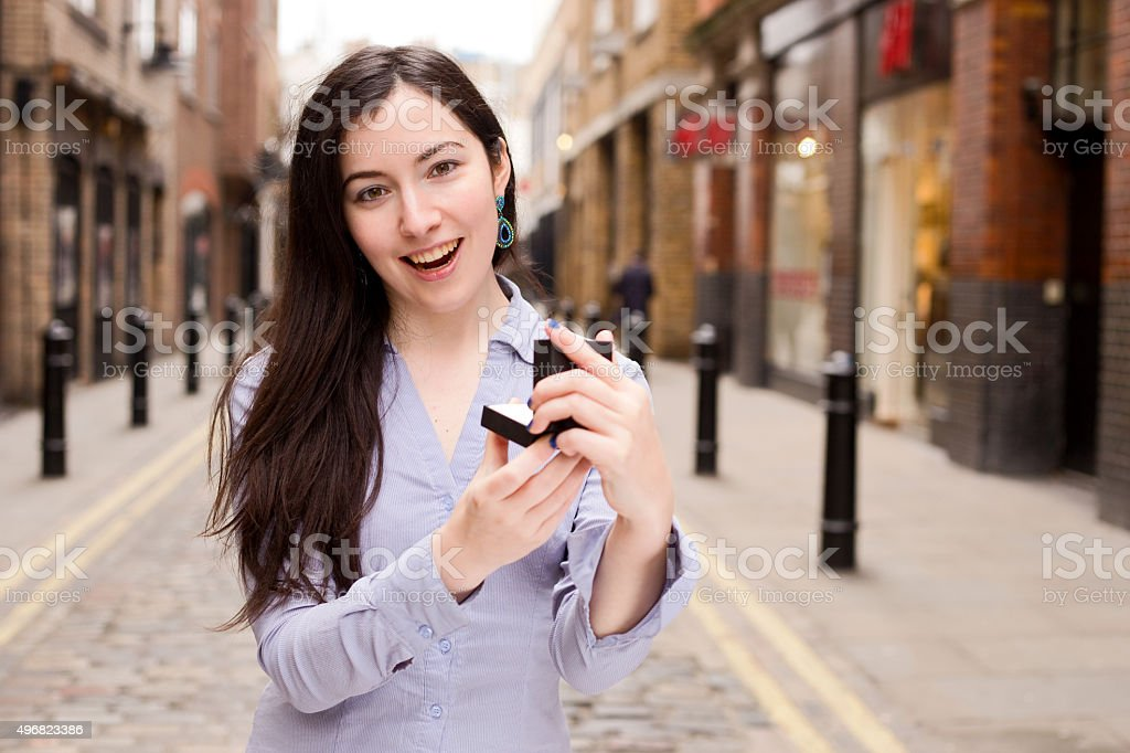 happy girl holding jewelry box royalty-free stock photo