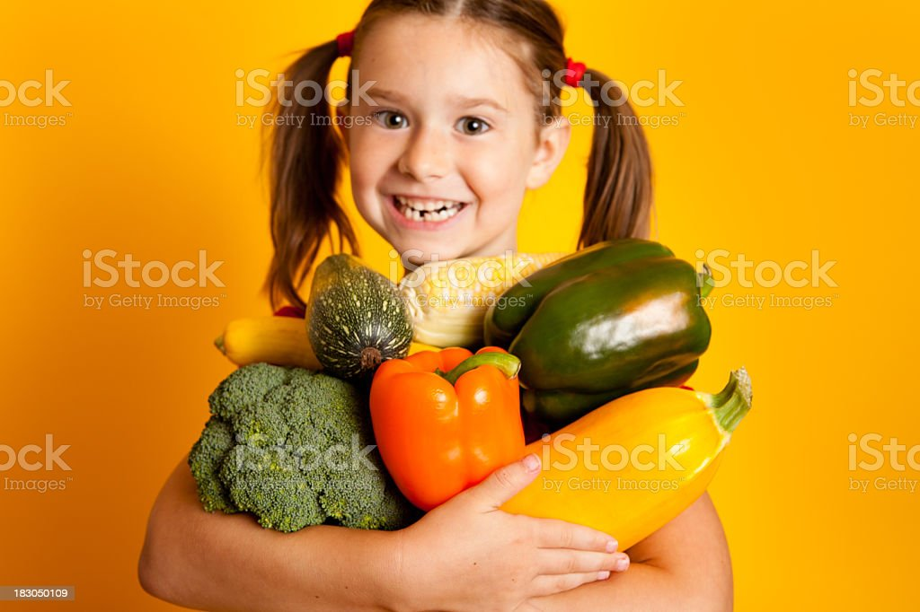 Happy Girl Holding Vegetables, Bell Peppers, Broccoli, Squash, Zucchini, Corn royalty-free stock photo
