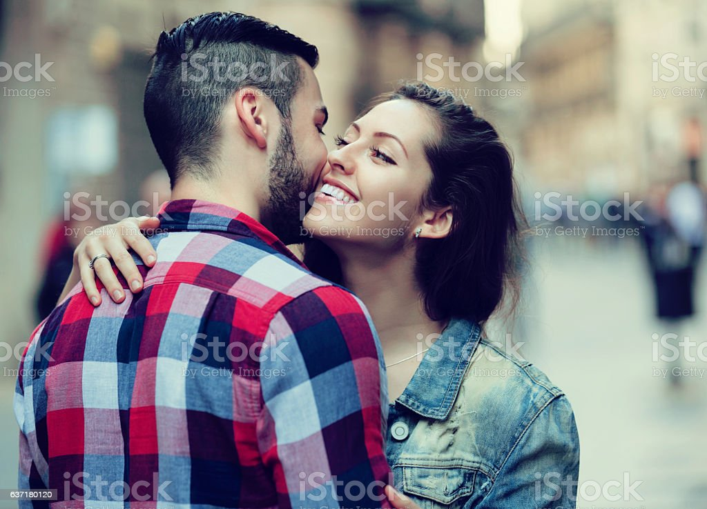 Happy girl hugging her male stock photo