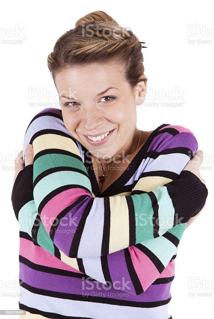 Happy Girl Hugs Herself stock photo