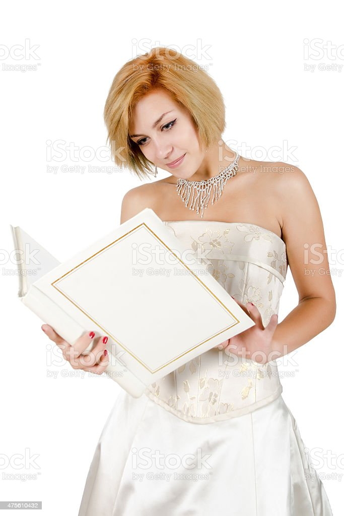 Happy girl in a white evening dress and necklace. stock photo