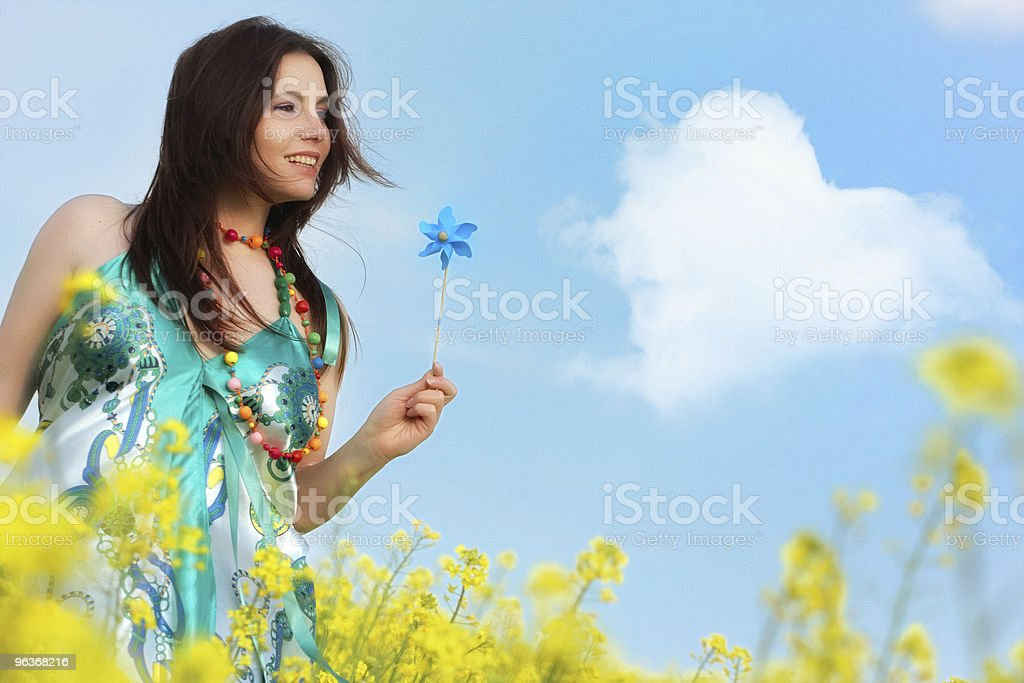 Happy girl in a yellow field royalty-free stock photo
