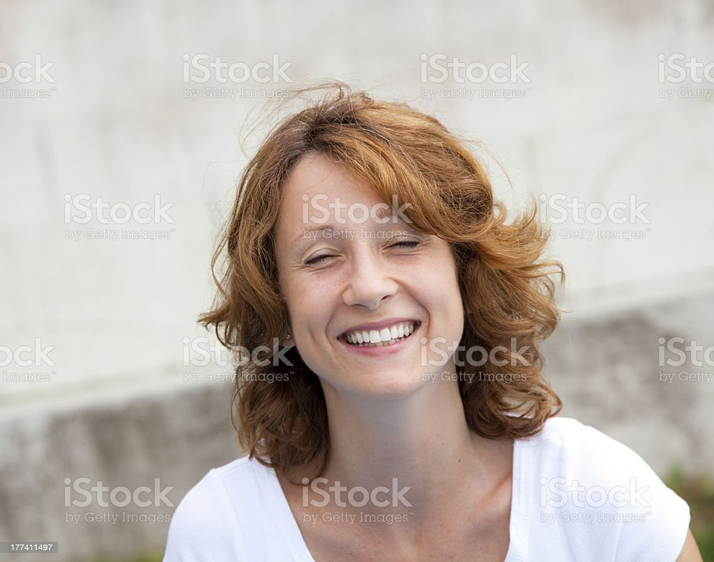 happy girl in front of a wall royalty-free stock photo