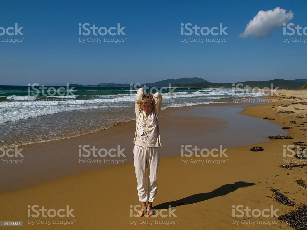 happy girl in night suit on the beach stock photo