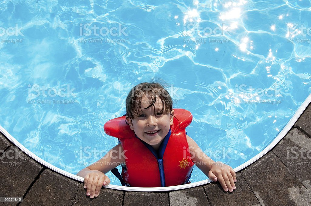 Happy girl in swimming pool stock photo