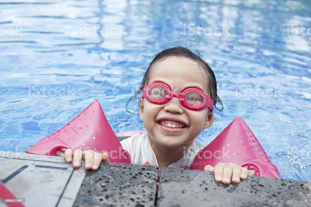 Happy Girl in Swimming Pool with Goggles royalty-free stock photo