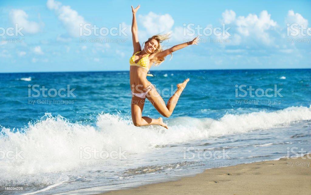 happy girl jumping at beach royalty-free stock photo