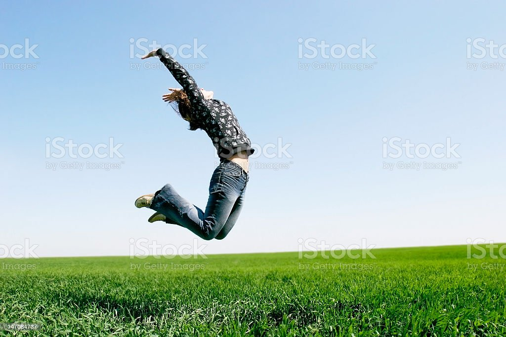 happy girl jumping on natural background royalty-free stock photo