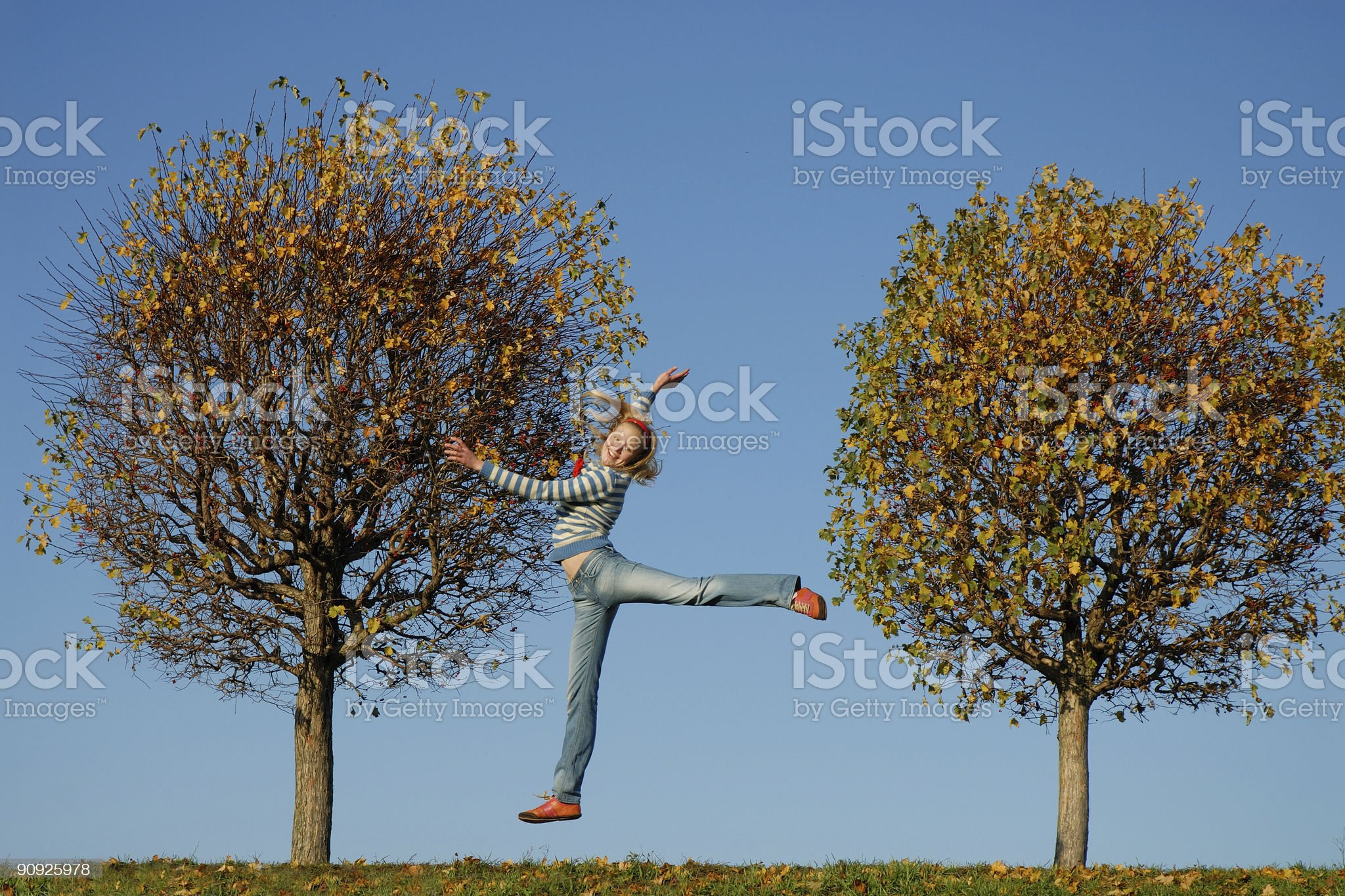 Happy girl jumpinng one hand up royalty-free stock photo